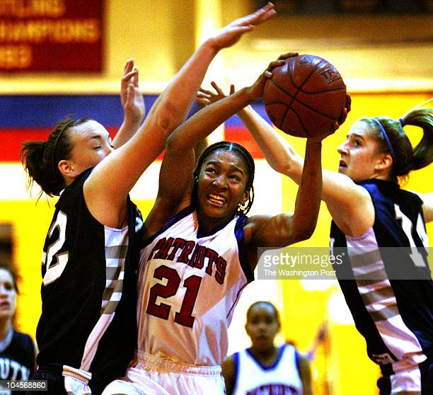 Mark Gail/ TWP Millersville, Md. ASSIGNMENT#:188689 EDITED BY: mg Old Mill's Ashley Jones goes to the basket between South River's Katherine Sullivan...