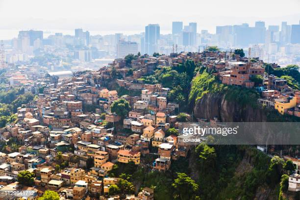 slum and downtown at rio de janeiro - favela stock pictures, royalty-free photos & images