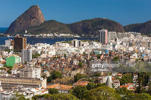 slum and middle class neighborhood - emerging markets stock photos and pictures