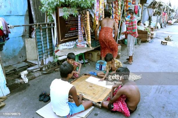 Slum area Children play carrom board during a governmentimposed nationwide lockdown as a preventive measure against the COVID19 coronavirus in...