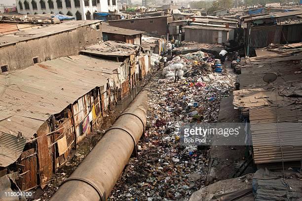 slum area, mumbai (bombay), india - slum stock pictures, royalty-free photos & images