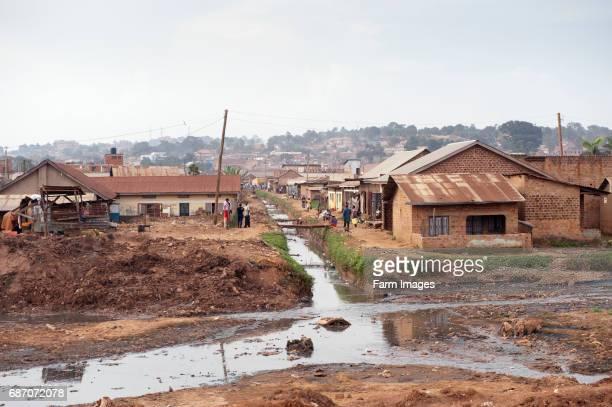 Slum area of Kampala Uganda next to a heavily polluted river