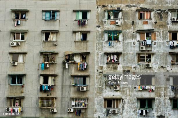 slum building in saigon outskirts - slum stock pictures, royalty-free photos & images