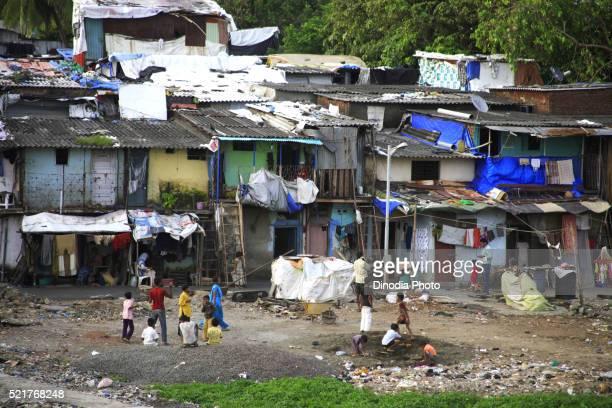 Slum children playing, Bandra, Bombay, Mumbai, Maharashtra, India