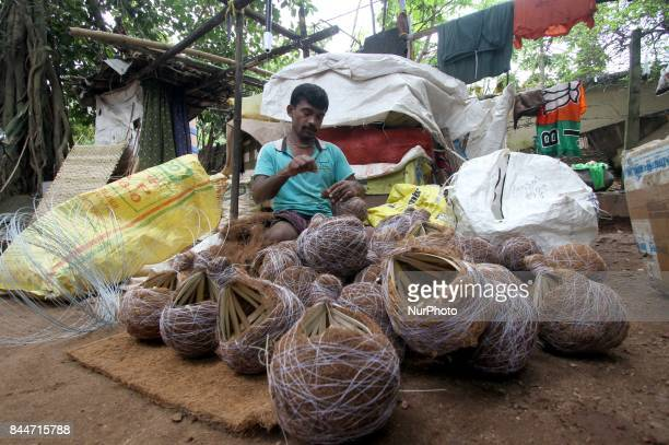 A slum dweller prepares fancy bird nests for sale it in the festivities session in the eastern Indian state Odishas capital city Bhubaneswar on 9...