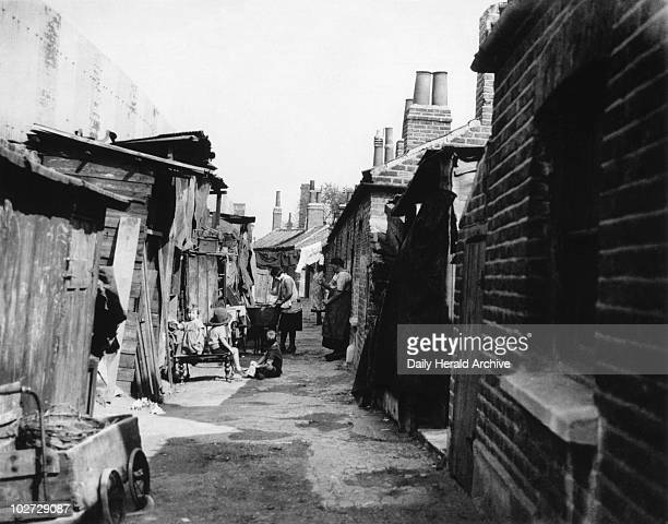 Slum housing South London 7 September 1934 Woodlands Cottages Camberwell in South London Photograph by Edward G Malindine