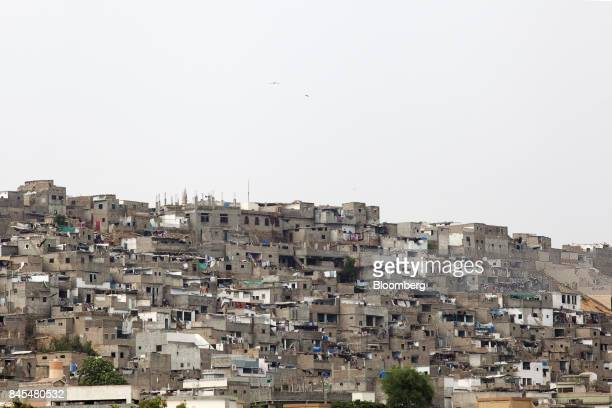 Slum housing stands on a hill in the Orangi town area of Karachi Pakistan on Wednesday Aug 23 2017 The murder of Orangi Pilot Project director...