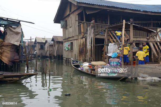 Slum neighborhood Makoko on March 17 2016 in Lagos Nigeria At present its population is considered to be around 200000 It was established in the 18th...