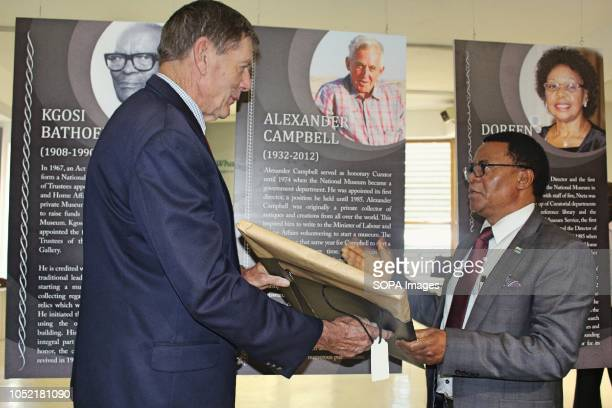 Slumber Tsongwane Vice President of the Republic of Botswana recognising Alec Cambell one of the founders of the Botswana national museum by gifting...