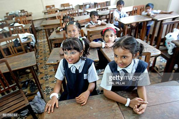 'Slumdog Millionaire' child actor Rubina Ali Qureshi waits in a classroom during her school's Annual Day function in Mumbai on February 28 2009...