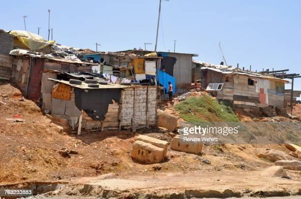 slums against clear sky - barriada fotografías e imágenes de stock