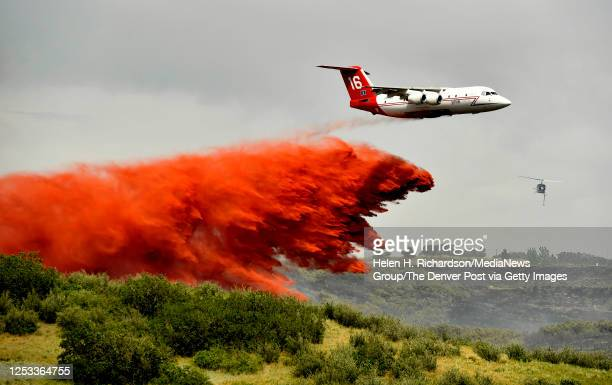 Slurry bomber drops its load of slurry onto the Chatridge 2 fire on June 29, 2020 in Highlands Ranch, Colorado. The fire burned 461 acres in the...