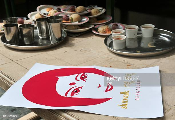 A 'SlutWalk Bengaluru Gejje Hejje' campaign poster lies on a dining table during a press conference held in Bangalore to announce the start of a...