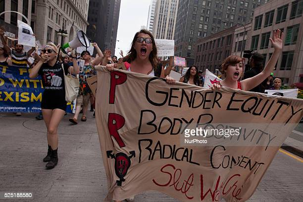 Slutwalk protestors march north on Michigan Ave in downtown Chicago to protest the system that blames victims for sexual assaults August 23rd 2014