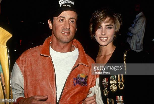 Sly Stallone and Jennifer Flavin attend the Grand Opening of Planet Hollywood on October 22, 1991 in New York City.