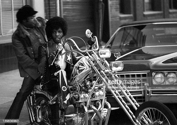 Sly Stone and his manager and producer Bubba Banks of the psychedelic soul group 'Sly and the Family Stone' rides a chopper on April 3 1973 in San...