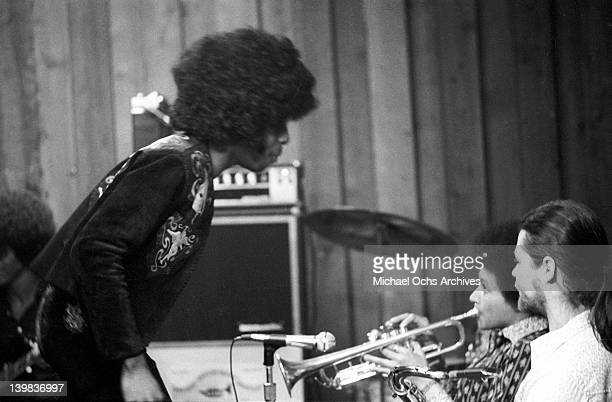 Sly Stone Cynthia Robinson and Jerry Martini of the psychedelic soul group 'Sly and the Family Stone' record in the studio on April 3 1973 in San...