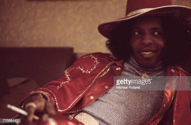 Sly Stone of Sly And The Family Stone posed smoking a cigarette in London on 16th July 1973