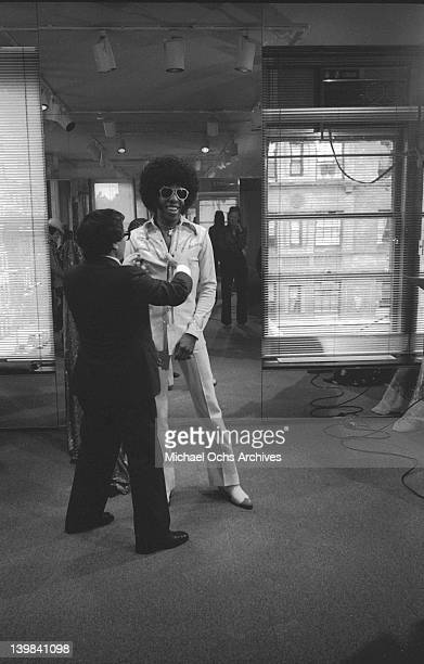 Sly Stone of the psychedelic soul group 'Sly And The Family Stone' gets fitted by fashion designer Halston on June 19 1974 in New York New York