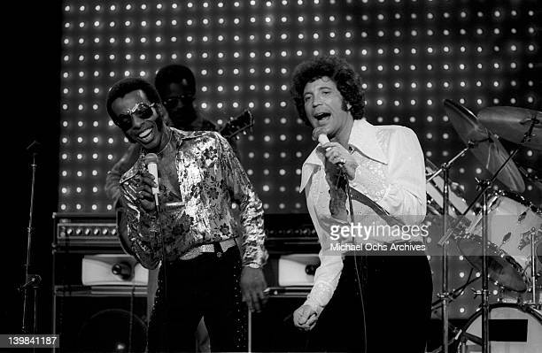 Sly Stone of the psychedelic soul group 'Sly And The Family Stone' performs on the TV show 'The Midnight Special' with pop singer Tom Jones on...