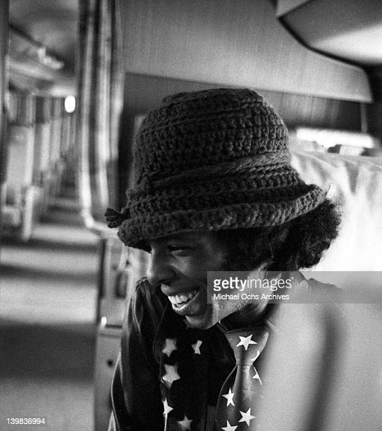 Sly Stone of the psychedelic soul group 'Sly and the Family Stone' sits aboard a plane in San Diego to do a radio interview on March 26 1969 n San...