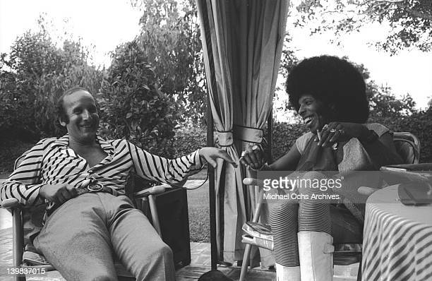 Sly Stone of the psychedelic soul group 'Sly The Family Stone' poses for a portrait sesion with record executive Clive Davis on September 27 1972
