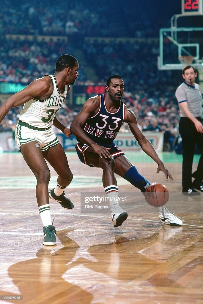 Sly Williams #33 of the New York Knicks drives the ball up court against the Boston Celtics during a game played in 1983 at the Boston Garden in Boston, Massachusetts.
