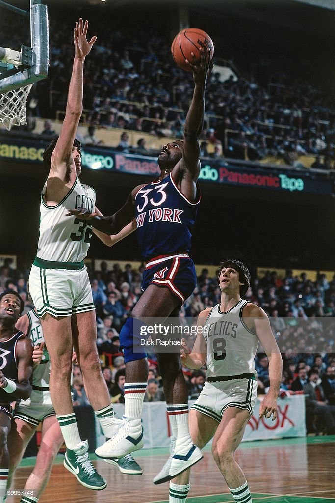 Sly Williams #33 of the New York Knicks shoots a layup against Kevin McHale #32 of the Boston Celtics during a game played in 1983 at the Boston Garden in Boston, Massachusetts.