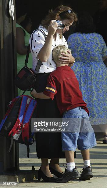 sm_firstday 082404 Sunderland Md Mark Gail/TWP Carole Koller gets a hug from her first grader son Christopher Poole as has he prepares to enter...
