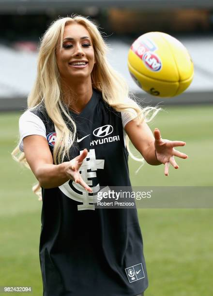 Smackdown women's champion Carmella and WWE'S world champion AJ Styles show their football skills at the Melbourne Cricket Ground on June 24 2018 in...