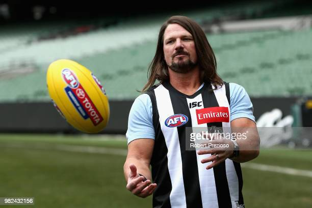 Smackdown women's champion Carmella and WWE'S world champion AJ Styles show their football skills at the Melbourne Cricket Ground on June 24, 2018 in...
