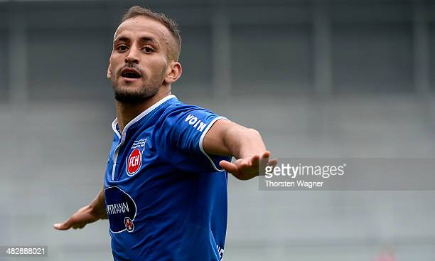 Smail Morabit of Heidenheim celebrates after scoring his teams opening goal during the third league match between SV Wehen Wiesbaden and 1.FC...