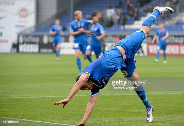 Smail Morabit of Heidenheim celebrates after scoring his teams opening goal with a flick flack during the third league match between SV Wehen...