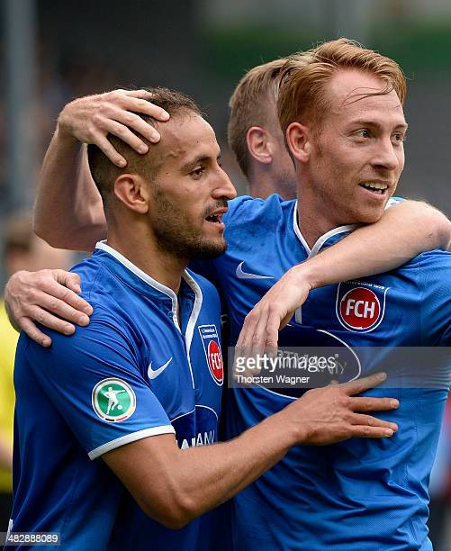 Smail Morabit of Heidenheim celebrates after scoring his teams opening goal with his team mate Tim Goehlert during the third league match between SV...