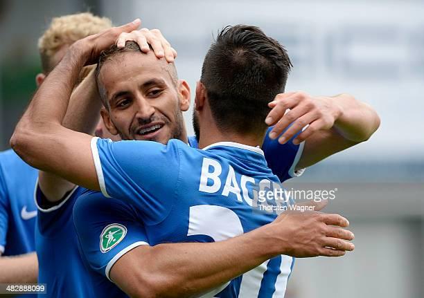 Smail Morabit of Heidenheim celebrates after scoring his teams opening goal with his team mate Alper Bagceri during the third league match between SV...