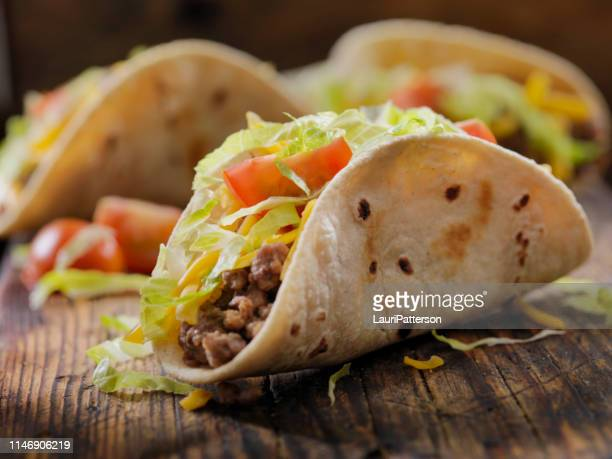small 4inch soft beef tacos - mexican food stock pictures, royalty-free photos & images