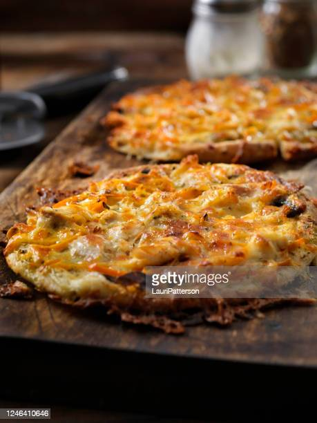 """small 8"""" thin crust roast chicken pizza with alfredo sauce, mushrooms and red peppers on pita bread - tortilla flatbread stock pictures, royalty-free photos & images"""