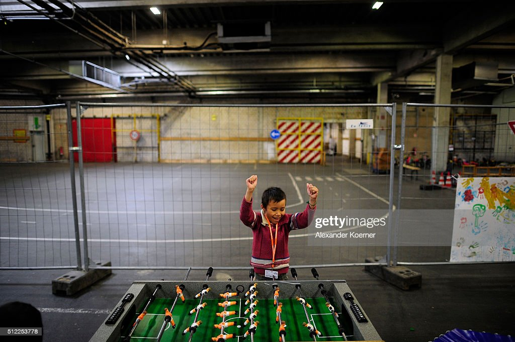 A small Afghan boy cheers while playing table football with other kids inside a shelter where they live while their asylum applications are processed on February 25, 2016 in Sarstedt, Germany. Germany received approximately 1.1 million newcomers in 2015 and is now facing the arduous task of processing asylum claims and taking steps to integrate those whose applications are accepted.
