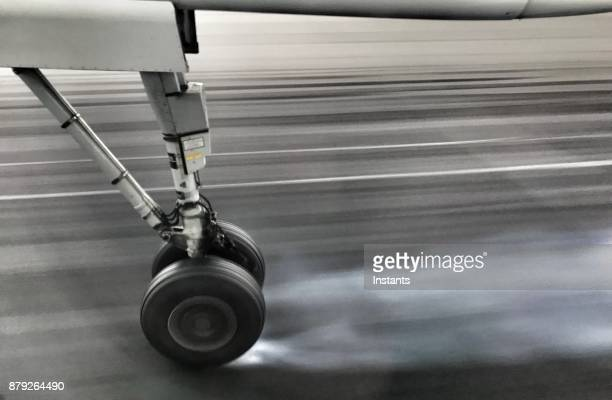 small airplane wheel on the airport runway. - landing gear stock photos and pictures
