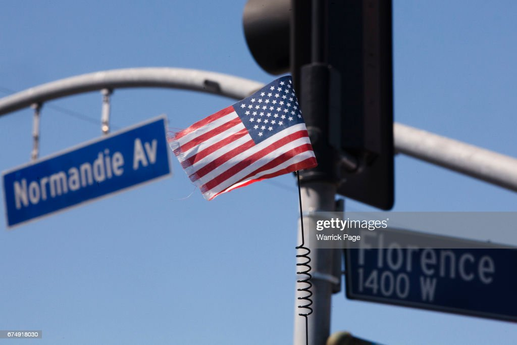 A small American flag flies on the back of a lowrider at the intersection of Florence and Normandie, on the 25th anniversary of the LA riots, on April 29, 2017 in Los Angeles, California. Florence and Normandie was the flashpoint for the riots that was sparked by the police acquittals in the Rodney King beating.