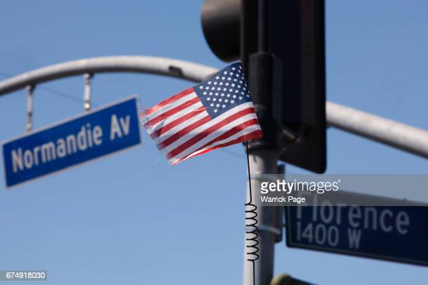 A small American flag flies on the back of a lowrider at the intersection of Florence and Normandie on the 25th anniversary of the LA riots on April...