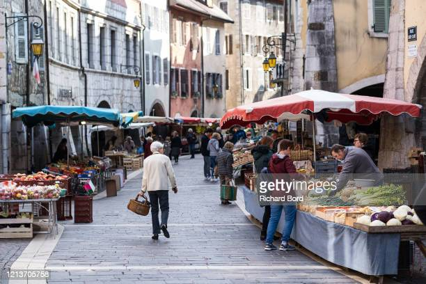 A small amount of people continue to shop at the Annecy market on March 20 2020 in Annecy France Coronavirus has spread to over 156 countries in a...