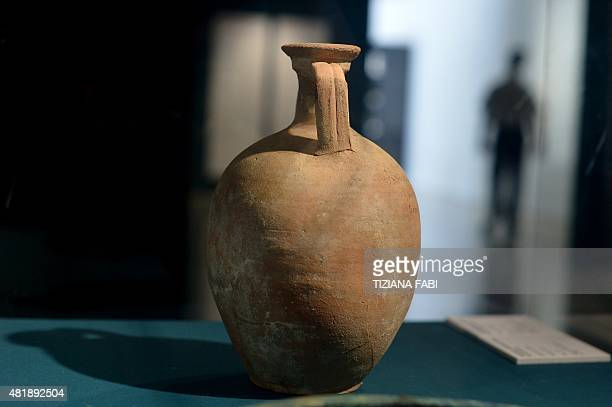 A small amphora for wheat is displayed during the exhibition 'Feeding the Empire Tales of food from Rome and Pompei'' at Ara Pacis Museum in Rome on...