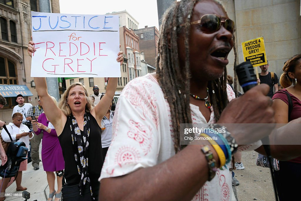 A small and peacful group of demonstrators gather to protest in front of the Baltimore City Circuit Courthouse East where pre-trial hearings will be held for six police officers charged in the death of Freddie Gray September 2, 2015 in Baltimore, Maryland. Earlier this year Gray, 25, suffered a severe spinal cord injury while in police custody and later died. His funeral was followed by rioting, looting and arson.