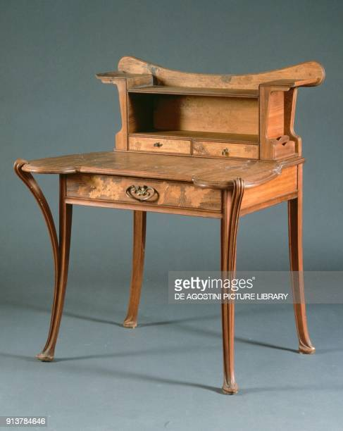 Small Art Nouveau bureau for ladies in molded and carved walnut made by Louis Majorelle France 19th century