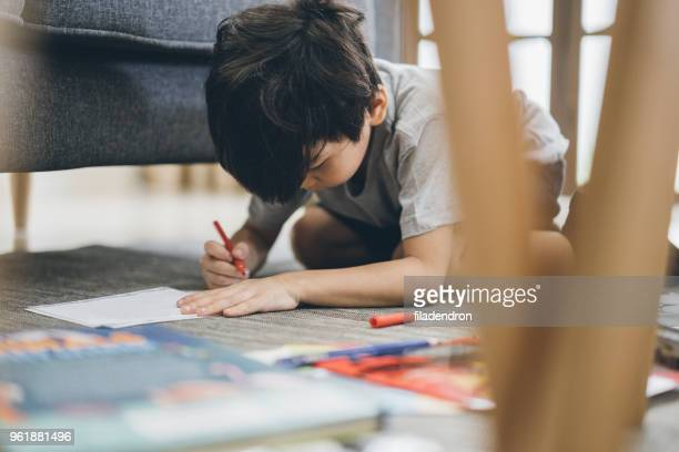 small asian boy drawing - colouring stock pictures, royalty-free photos & images