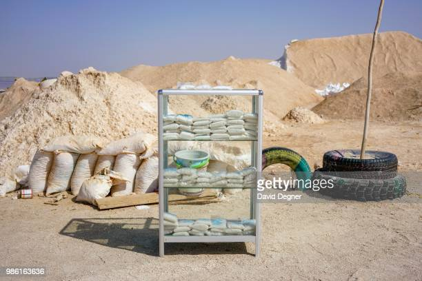 Small baggies of salt are sold to tourists beside Lac Rose on the edge of Dakar Senegal Lac Rose is a saline lake that gets its color from a special...