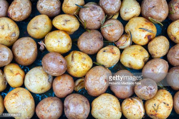 Small baked potatoes of two colors forming a food pattern. Prepared potatoes are a staple in the Canadian diet.