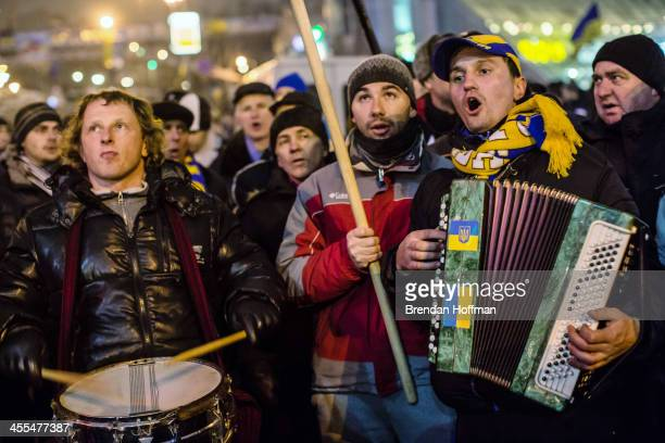 A small band performs while walking around Independence Square during ongoing antigovernment protests on December 12 2013 in Kiev Ukraine Thousands...
