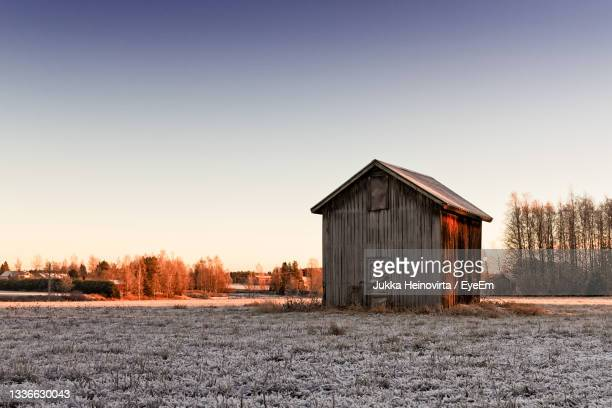 small barn house in the winter sunrise - heinovirta stock pictures, royalty-free photos & images